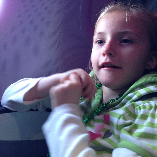 Claire on our flight to Boston, so happy to be doing her little part.